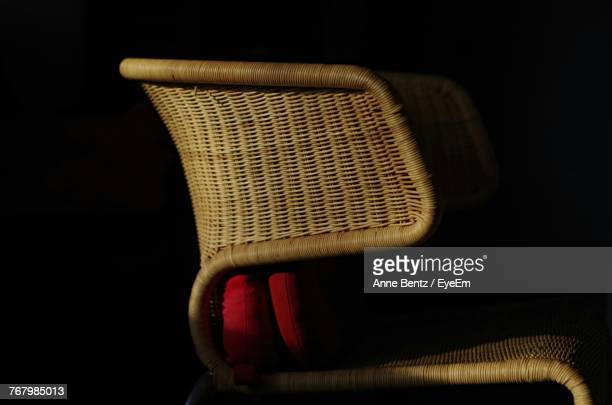 close-up of wicker chair against black background - wicker stock pictures, royalty-free photos & images