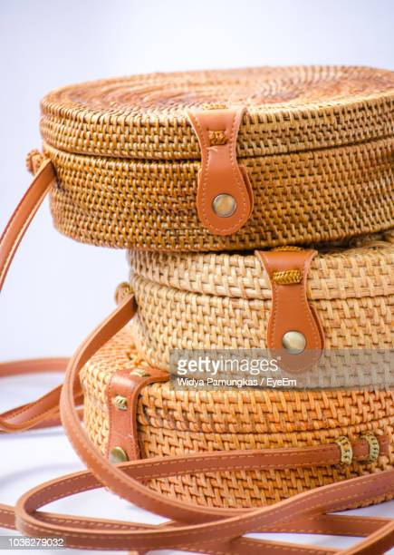 close-up of wicker containers against white background - brown purse stock pictures, royalty-free photos & images