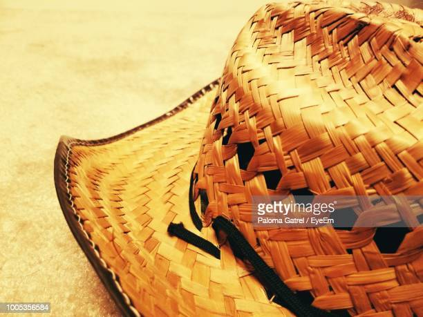 Close-Up Of Wicker Hat On Sand At Beach