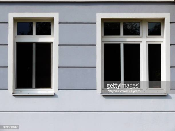 close-up of window amidst wall - wall building feature stock pictures, royalty-free photos & images