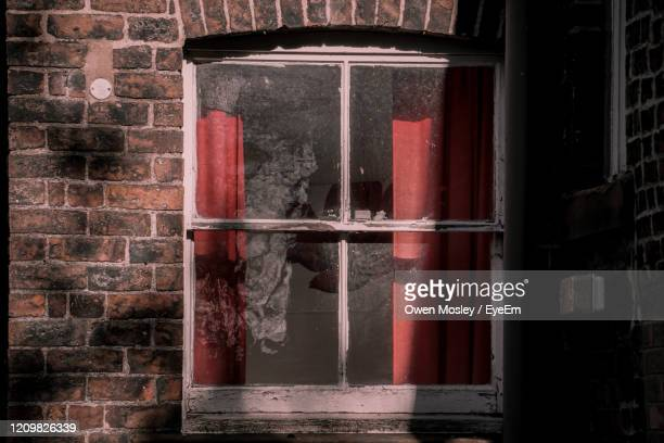 close-up of window on old building - carlisle stock pictures, royalty-free photos & images