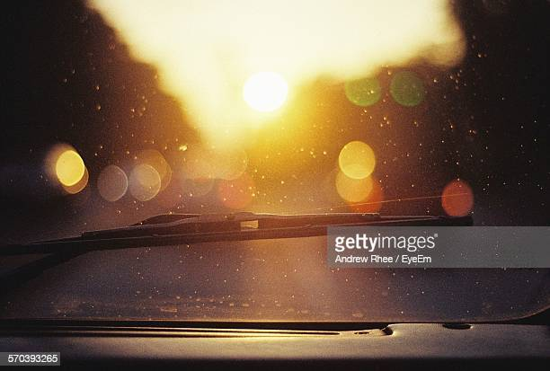 close-up of windshield wiper during sunset - windshield wiper stock photos and pictures