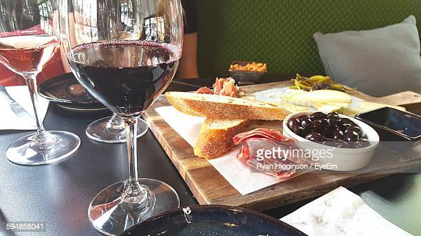Close-Up Of Wine And Food On Table