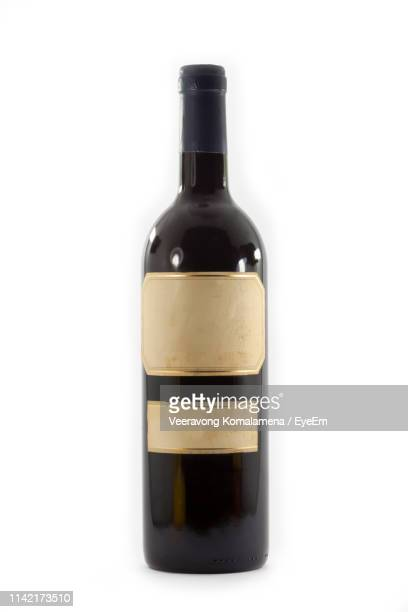 close-up of wine bottle against white background - wine bottle stock pictures, royalty-free photos & images