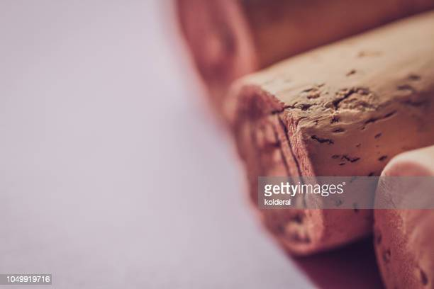 close-up of wine corks on white background - maroon stock pictures, royalty-free photos & images