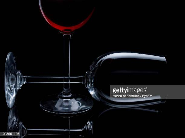 Close-Up Of Wine Glasses Against Black Background