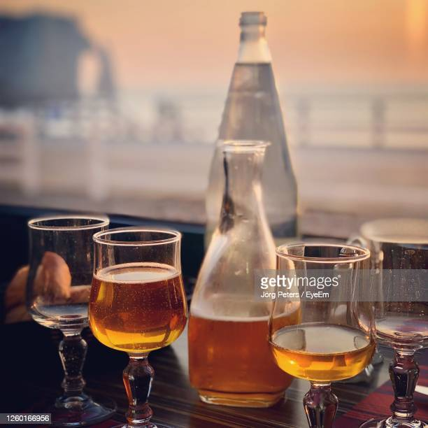 "close-up of wine glasses on table at sunset in etretat - ""jörg peters"" stock-fotos und bilder"