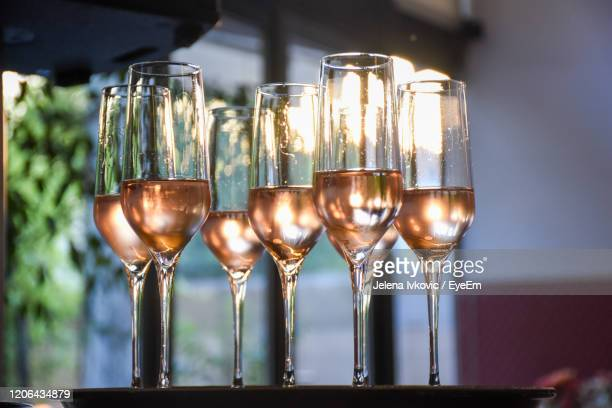 close-up of wine glasses on table - jelena ivkovic stock pictures, royalty-free photos & images