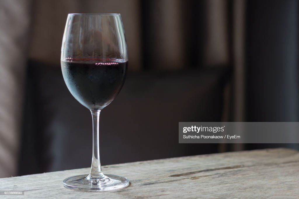 Close-Up Of Wine In Glass On Table : Stock Photo