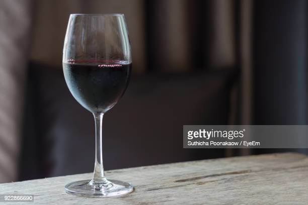 close-up of wine in glass on table - wine glass stock pictures, royalty-free photos & images
