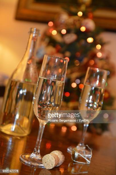 Close-Up Of Wine Served Against Christmas Tree On Table
