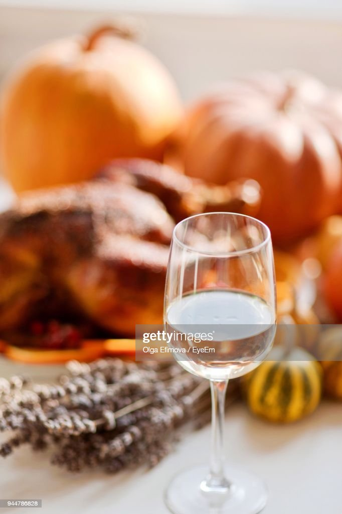 Close-Up Of Wine With Food On Table : Stock Photo