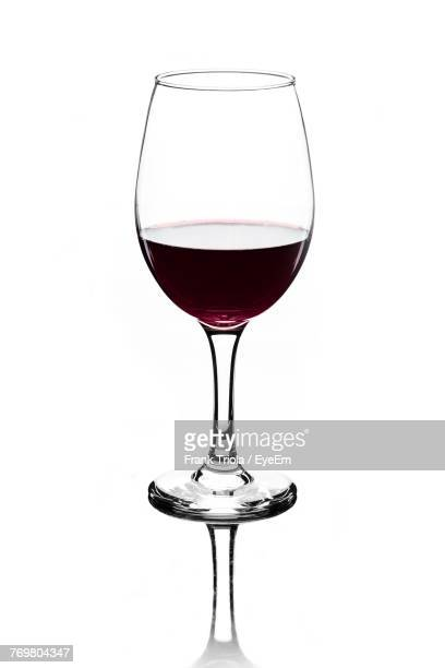 close-up of wineglass against white background - wine glass stock photos and pictures