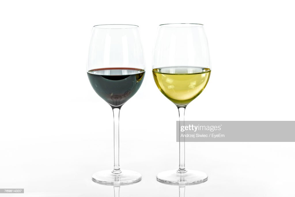 Close-Up Of Wineglass Against White Background : Stock Photo