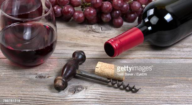 close-up of wineglass and bottle on table - cork material stock photos and pictures