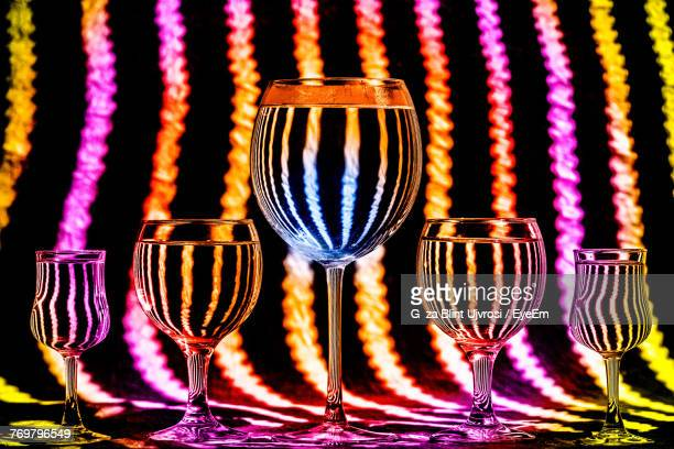 Close-Up Of Wineglasses Against Abstract Backgrounds