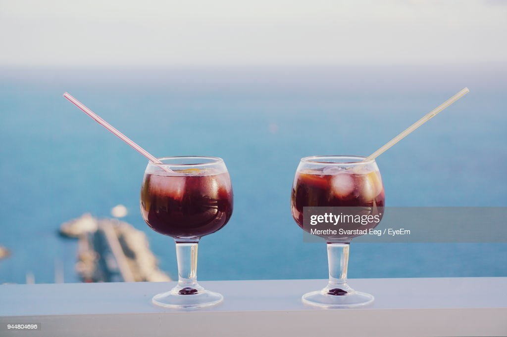 Close-Up Of Wineglasses Against Sea : Stock Photo