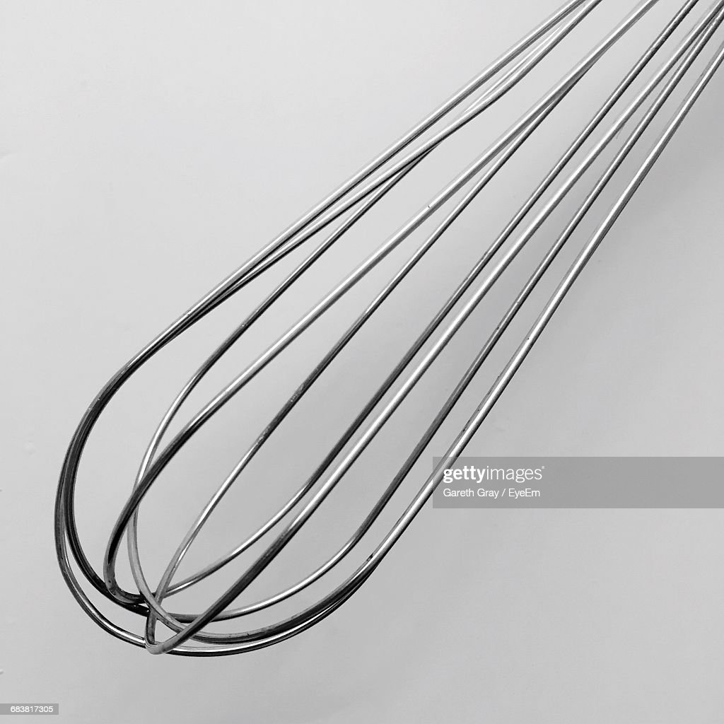 Closeup Of Wire Whisk On White Background Stock Photo | Getty Images