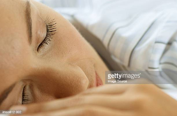 close-up of woman asleep - pores stock photos and pictures