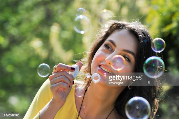 Close-Up Of Woman Blowing Bubble