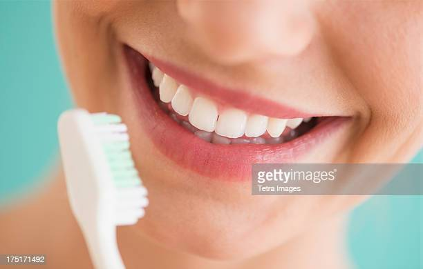 Close-up of woman brushing teeth
