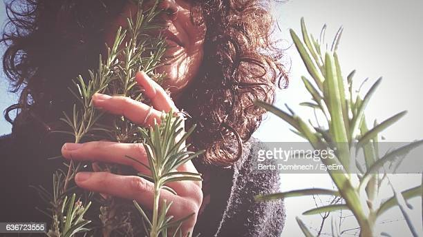 Close-Up Of Woman By Plants Against Sky