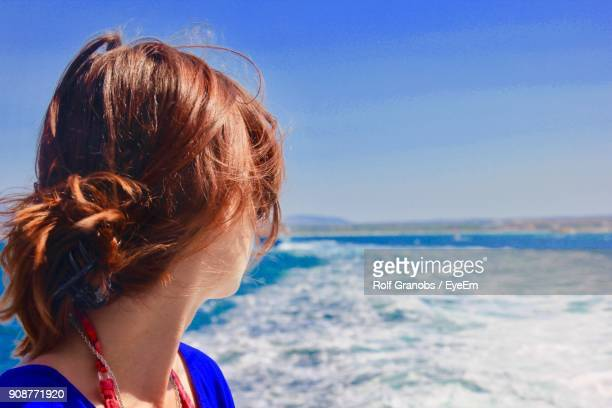 Close-Up Of Woman By Sea Against Sky