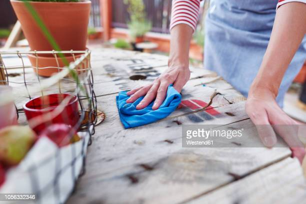 close-up of woman cleaning the table at a cafe - rubbing stock pictures, royalty-free photos & images
