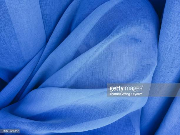 Close-Up Of Woman Covered In Blue Fabric