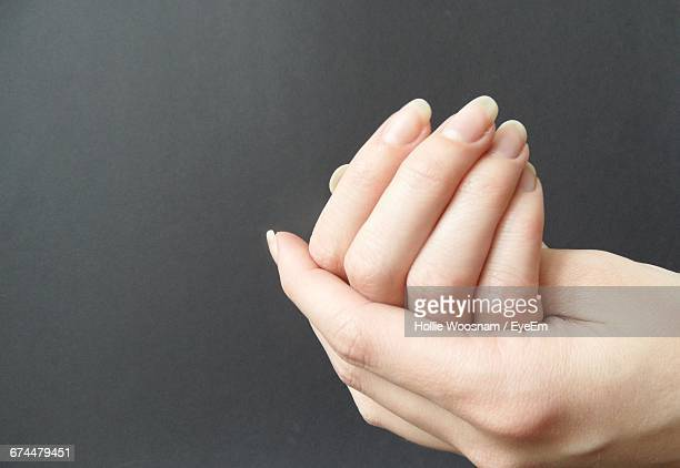 close-up of woman cupping hands - rubbing stock pictures, royalty-free photos & images