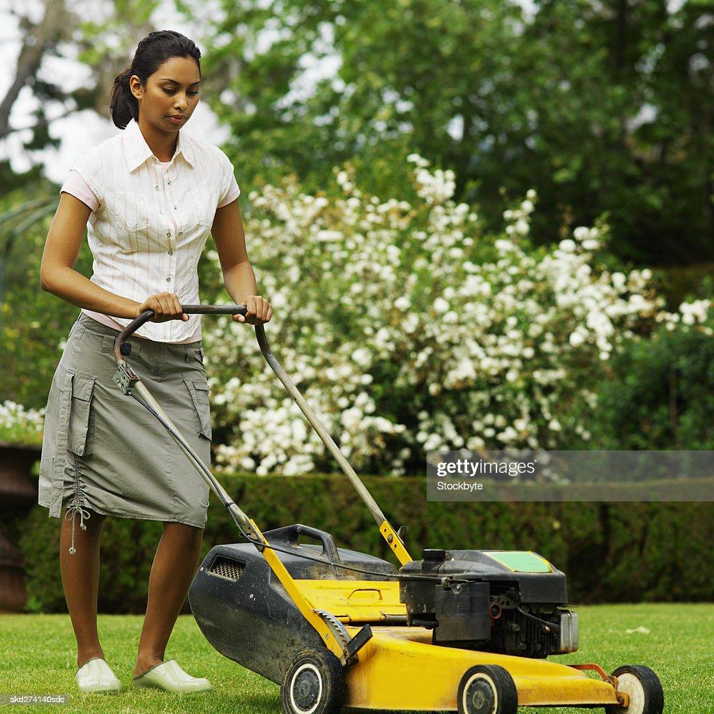 Woman In Field Garden Job Driving A Lawn Mower Stock Image