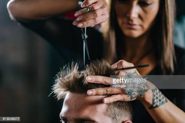 Close-Up Of Woman Cutting Man Hair