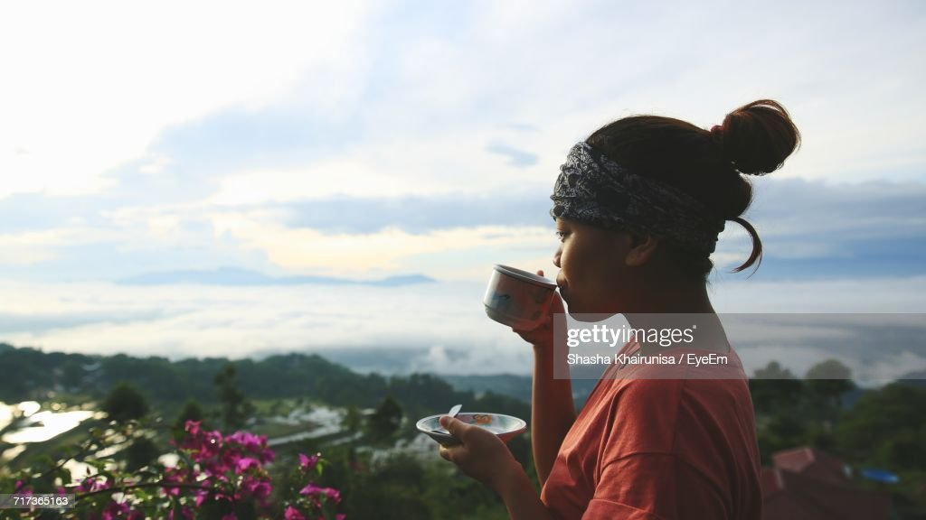 Close Up Of Woman Drinking Coffee Outdoors Stock Photo