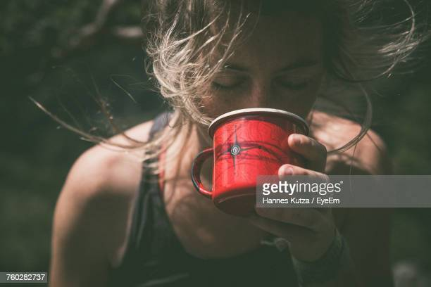 Close-Up Of Woman Drinking From Cup