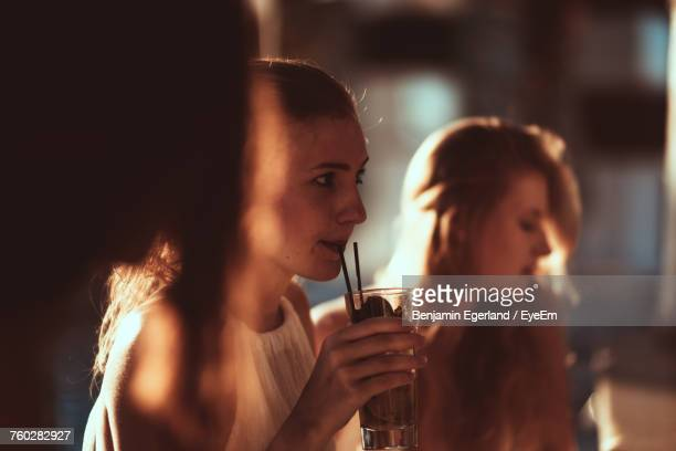 close-up of woman drinking from glass - cocktail party stock pictures, royalty-free photos & images