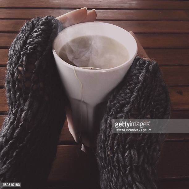 close-up of woman drinking herbal tea - hot tea stock pictures, royalty-free photos & images