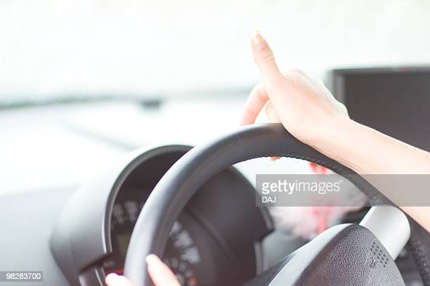 Close-up of woman driving a car