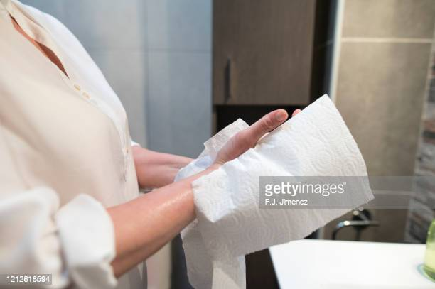 close-up of woman drying her hands with paper - drying stock pictures, royalty-free photos & images