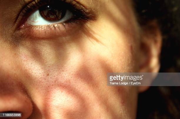 close-up of woman eye and cheek - skin stock pictures, royalty-free photos & images