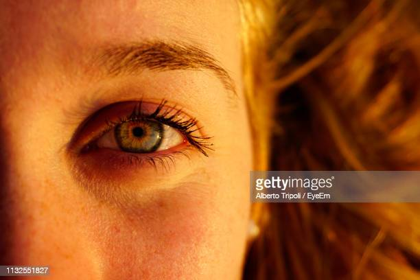 close-up of woman eye - extreme close up stock pictures, royalty-free photos & images