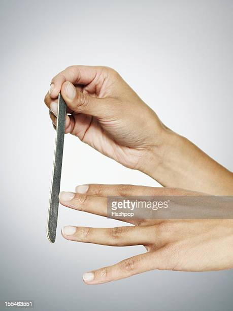 Close-up of woman filing her nails