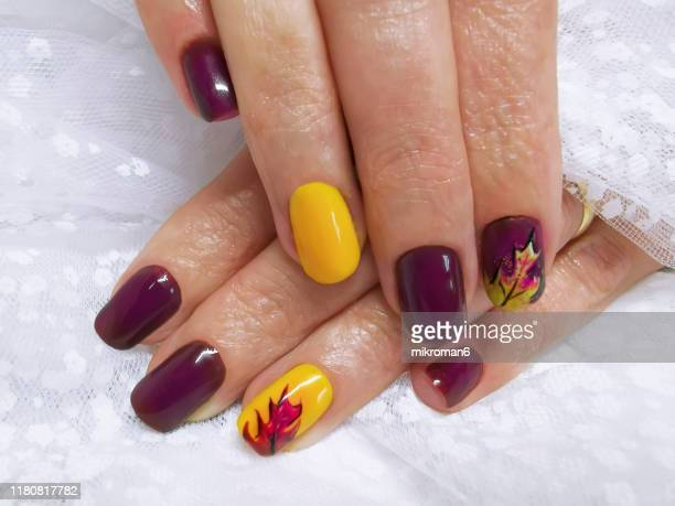 close-up of woman fingers with nail art, autumn inspired nail designs - nail art stock pictures, royalty-free photos & images