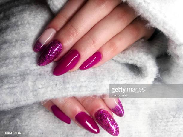 close-up of woman fingers with nail art manicure in pink colour - nail art stock pictures, royalty-free photos & images
