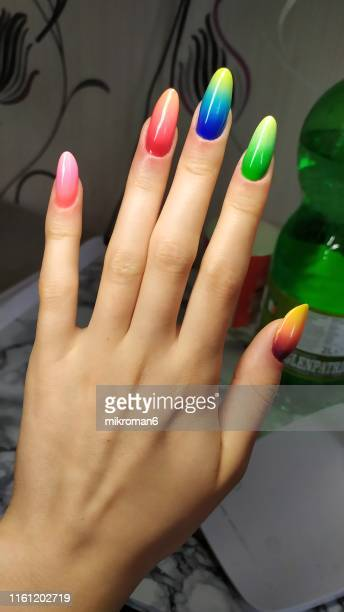 close-up of woman fingers with nail art manicure with neon rainbowcolour - nail art stock pictures, royalty-free photos & images