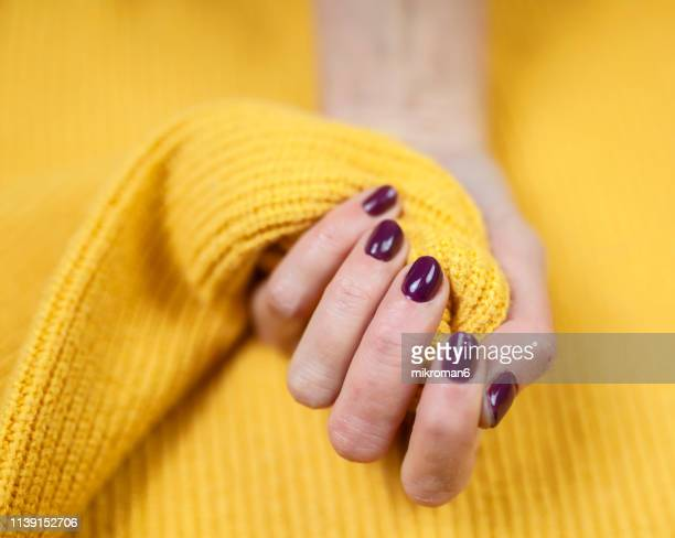Close-Up Of Woman Fingers With Nail Art. Maroon nail polish
