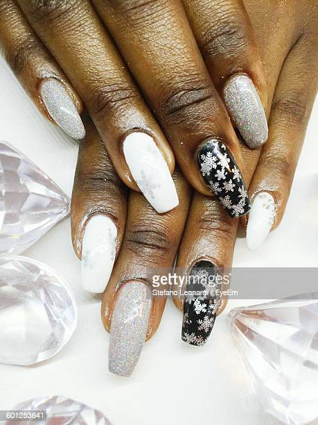 Close-Up Of Woman Fingers With Nail Art