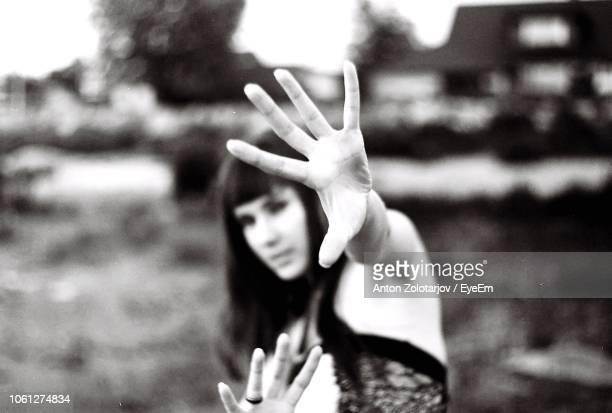 Close-Up Of Woman Gesturing Outdoors