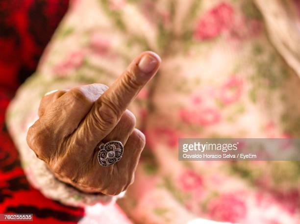 close-up of woman gesturing - old lady middle finger stock pictures, royalty-free photos & images
