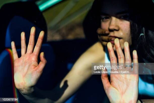 close-up of woman getting kidnapped - kidnapping stock pictures, royalty-free photos & images