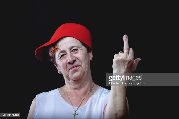 close-up of woman giving middle finger - old lady middle finger stock pictures, royalty-free photos & images